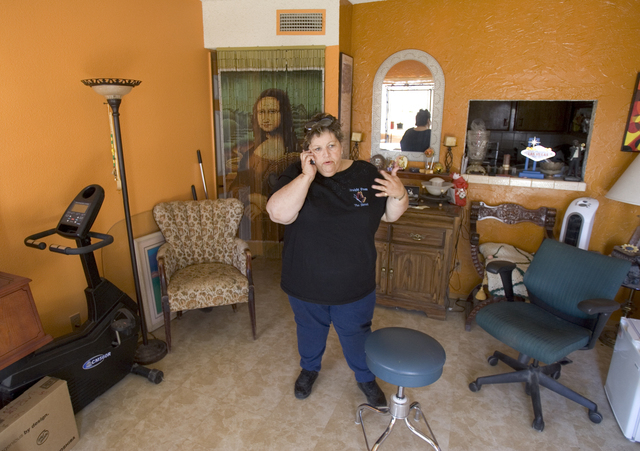 Homeless advocate Linda Lera-Randle El, founder and director of the Straight From the Streets charity, talks on the phone in her Las Vegas home, Feb. 10, 2006. Lera-Randle El was voted Favorite Fe ...