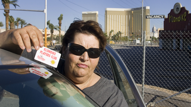 Homeless advocate Linda Lera-Randle El, founder and director of the Straight From the Streets charity, holds a Klondike Casino Players Card that she found whiles searching the abandoned Klondike h ...