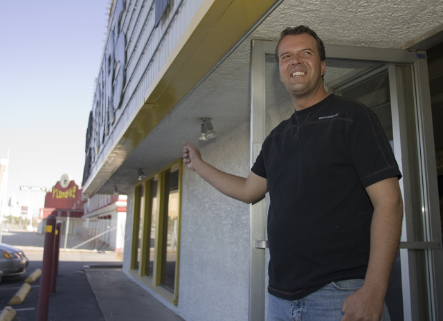 Las Vegas Tourist Bureau employee Don Medvi points at the abandoned Klondike hotel-casino as he talks about the homeless problems in the area, Thursday morning, Oct. 4, 2007, while standing outsid ...