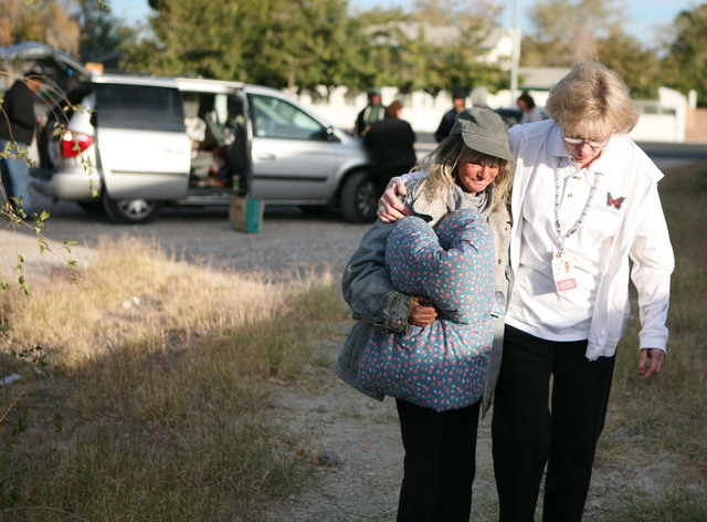 Straight from the Streets director Linda Lera-Randle El, right, walks with 54-year-old homeless woman Suzie Stanfield in a vacant lot off Lake Mead Boulevard where she is currently living Thursday ...