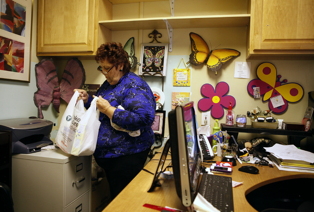 Linda Lera-Randle El packs up a bag of items for a client in her office at Straight from the Streets in Las Vegas Thursday, March 1, 2012. Lera-Randle El will receive an award from the American So ...