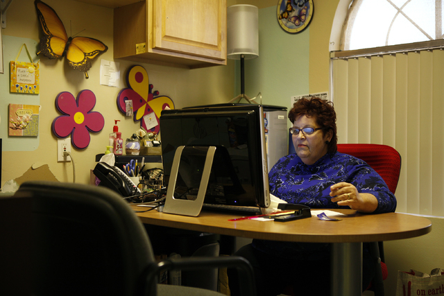 Linda Lera-Randle El works on a computer in her office at Straight from the Streets in Las Vegas Thursday, March 1, 2012. Lera-Randle El will receive an award from the American Society for Public  ...