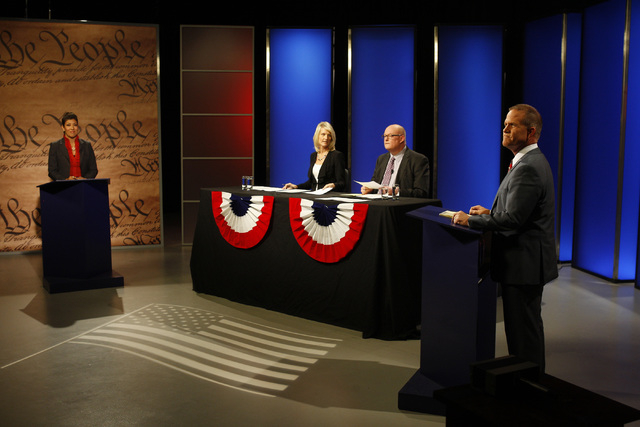 Nevada state Assemblywoman Lucy Flores, D-Las Vegas, and state Sen. Mark Hutchison, R-Las Vegas, take part in a debate for lieutenant governor Wednesday, Oct. 15, 2014 in a studio at Vegas PBS. (S ...