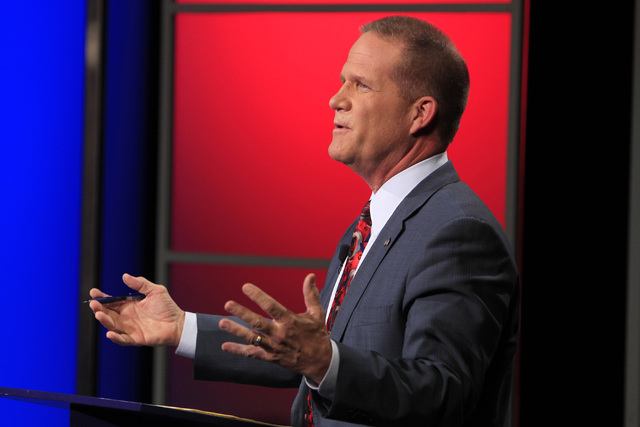 State Sen. Mark Hutchison, R-Las Vegas, takes part in a debate for lieutenant governor against Assemblywoman Lucy Flores, D-Las Vegas, Wednesday, Oct. 15, 2014 in a studio at Vegas PBS. (Sam Morri ...