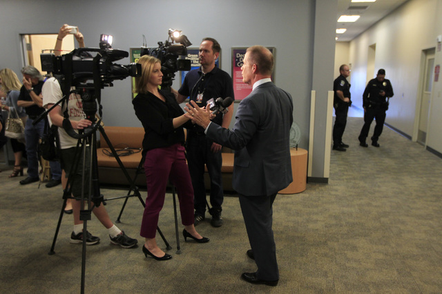 State Sen. Mark Hutchison, R-Las Vegas, talks to the media after his debate against Assemblywoman Lucy Flores, D-Las Vegas, in their race for lieutenant governor Wednesday, Oct. 15, 2014 in a stud ...