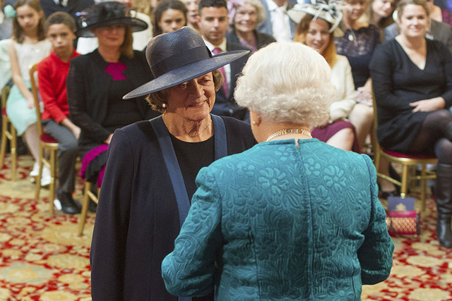Dame Maggie Smith is made a member of the Order of the Companion of Honour by Queen Elizabeth II during an investiture ceremony at Windsor Castle, England, Friday Oct. 17, 2014. (AP Photo/PA, Domi ...