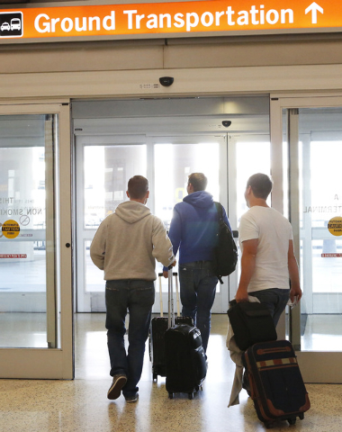 International passengers exit the airport at terminal 3, on Friday, Oct. 10, 2014, at McCarran International Airport in Las Vegas. (Bizuayehu Tesfaye/Las Vegas Review-Journal)