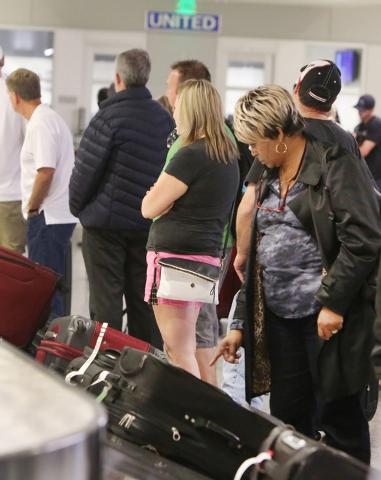 Passengers wait for their baggage at United Airlines terminal, on Friday, Oct. 10, 2014, at McCarran International Airport in Las Vegas. (Bizuayehu Tesfaye/Las Vegas Review-Journal)