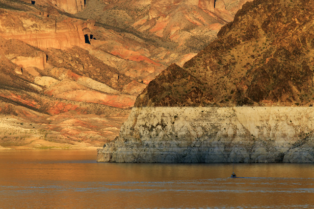 A boat travels towards the Hemenway Wall on Lake Mead Monday, Oct. 6, 2014. (Sam Morris/Las Vegas Review-Journal)