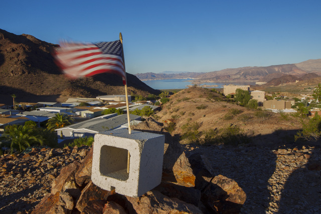 A U.S. flag flutters in the breeze above Lake Mead in Boulder City Monday, Oct. 6, 2014. (Sam Morris/Las Vegas Review-Journal)