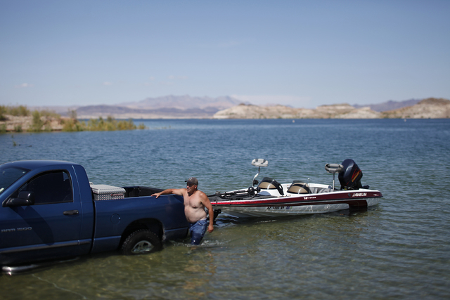 Robert Wade takes his fishing boat out of the water at the boat landing by the Las Vegas Boat Harbor on Lake Mead near Boulder City, Nev. Thursday, Sept. 15, 2011. (John Locher/Las Vegas Review-Jo ...