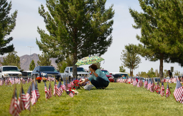 Narcisa Wright visits with her late husband, U.S. Air Force TSgt. Edward D. Wright, who served in the Korean War and the Vietnam War, at the Southern Nevada Veterans Memorial Cemetery in Boulder C ...