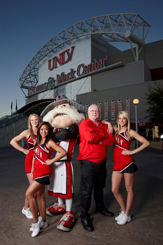 Mike Miller, creator of the Hey Reb mascot, poses with his creation and UNLV cheerleaders, from left, Sara Jordan, Asia Harman and Lindsay Myhre, in front of the Thomas and Mack Center Feb. 10, 20 ...