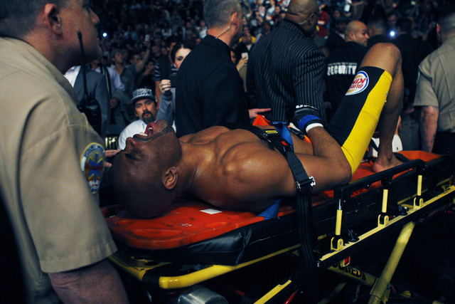 Anderson Silva gets carted out of the arena after breaking his leg in a match against Chris Weidman during UFC 168 on Saturday night. (Jason Bean/Las Vegas Review-Journal)