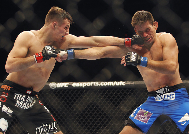 Rory MacDonald, left, hits Demian Maia during UFC 170 at the Mandalay Bay Events Center in Las Vegas on Saturday night, Feb. 22, 2014.  (Jason Bean/Las Vegas Review-Journal)