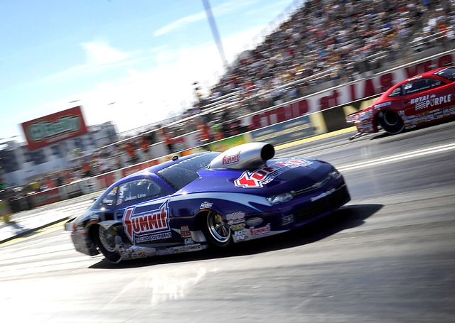 Driver Jason Line drives his pro stock dragster during a qualifying session at the 14th annual NHRA Nationals at The Strip at the Las Vegas Motor Speedway on Friday, Oct. 31, 2014. (David Becker/L ...