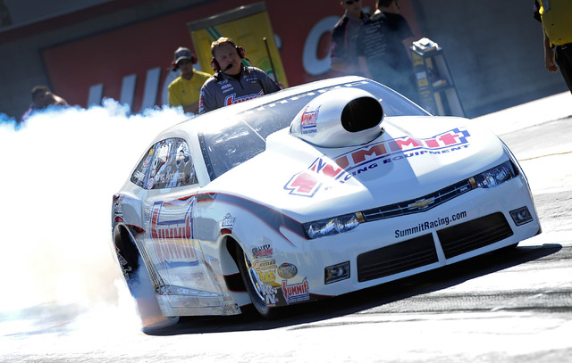 Driver Greg Anderson drives his pro stock dragster during a qualifying session at the 14th annual NHRA Nationals at The Strip at the Las Vegas Motor Speedway on Friday, Oct. 31, 2014. (David Becke ...