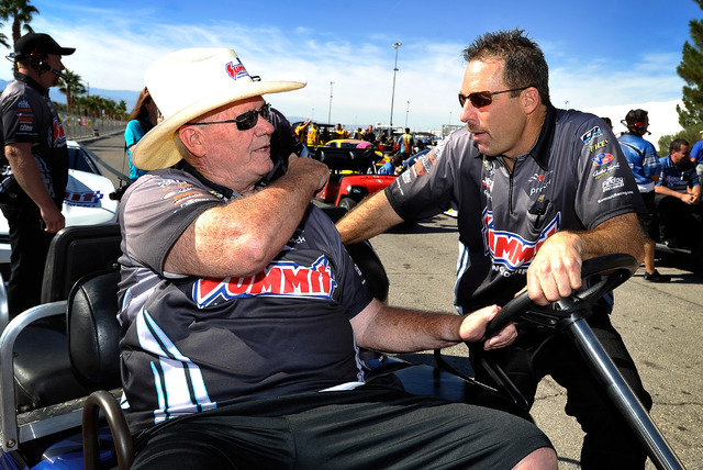 Team owner Ken Black, left, talks with driver, Greg Anderson before a qualifying session at the 14th annual NHRA Nationals at The Strip at the Las Vegas Motor Speedway on Friday, Oct. 31, 2014. (D ...