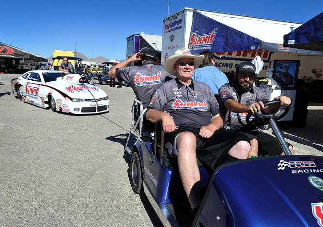Team owner Ken Black, wearing his cowboy hat, is driven to the starting line before a pro stock qualifying session at the 14th annual NHRA Nationals at The Strip at the Las Vegas Motor Speedway on ...