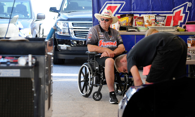 Team owner Ken Black, watches his mechanics work in the pit area before a pro stock qualifying session at the 14th annual NHRA Nationals at The Strip at the Las Vegas Motor Speedway on Friday, Oct ...