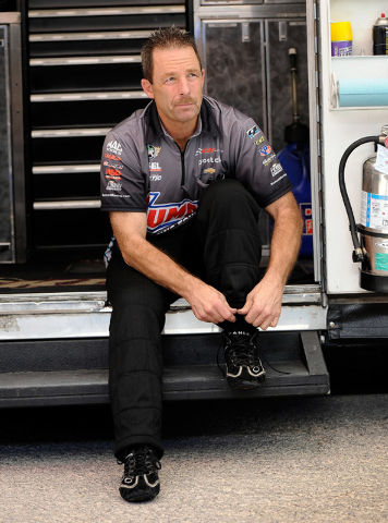 Driver Greg Anderson suits up  before a pro stock qualifying session at the 14th annual NHRA Nationals at The Strip at the Las Vegas Motor Speedway on Friday, Oct. 31, 2014. (David Becker/Las Vega ...