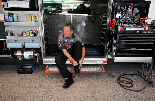 Driver Jason Line suits up  before a pro stock qualifying session at the 14th annual NHRA Nationals at The Strip at the Las Vegas Motor Speedway on Friday, Oct. 31, 2014. (David Becker/Las Vegas R ...