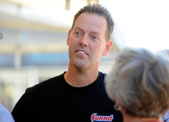 Driver Jason Line speaks with fans before a pro stock qualifying session at the 14th annual NHRA Nationals at The Strip at the Las Vegas Motor Speedway on Friday, Oct. 31, 2014. (David Becker/Las  ...