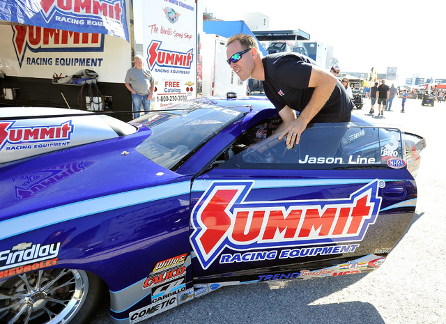 Driver Jason Line pushes his dragster before a pro stock qualifying session at the 14th annual NHRA Nationals at The Strip at the Las Vegas Motor Speedway on Friday, Oct. 31, 2014. (David Becker/L ...