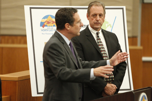 UNLV Director Robert Lang, left, speaks on the Economic Diversification District at Apex project as North Las Vegas Mayor John Lee looks on during a press conference at North Las Vegas City Hall T ...