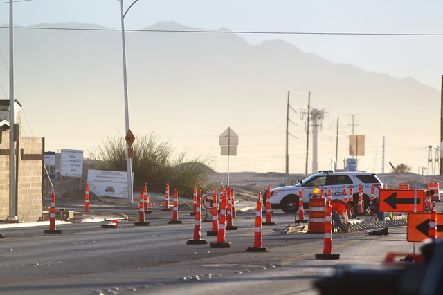 A North Las Vegas police officer is parked on Carey Avenue near Revere Street Wednesday morning, Oct. 8, 2014. A man was killed and an officer was wounded in a shootout Tuesday night near this int ...