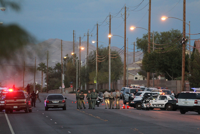 Police investigate a shooting near the intersection of Alexander Rd. and Revere Street in North Las Vegas on Wednesday, Oct. 8, 2014. (K.M. Cannon/Las Vegas Review-Journal)