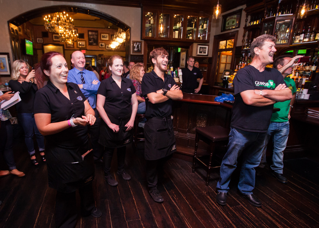 Restaurant staff and supporters cheer before the first performance in the Guinness World Record attempt for Longest Concert by Multiple Artists at Ri Ra Irish Pub inside The Shoppes at Mandalay Pl ...