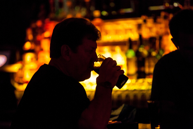 Musician John Windsor sips his beer while watching Dave Browne and Dave Rooney perform during a Guinness World Record attempt for Longest Concert by Multiple Artists at Ri Ra Irish Pub inside The  ...
