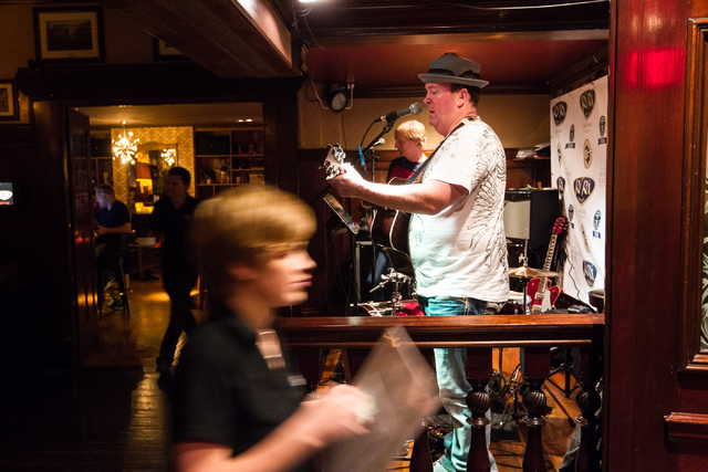 Dave Rooney, right, and Dave Browne, center, perform as the first act during a Guinness World Record attempt for Longest Concert by Multiple Artists at Ri Ra Irish Pub inside The Shoppes at Mandal ...