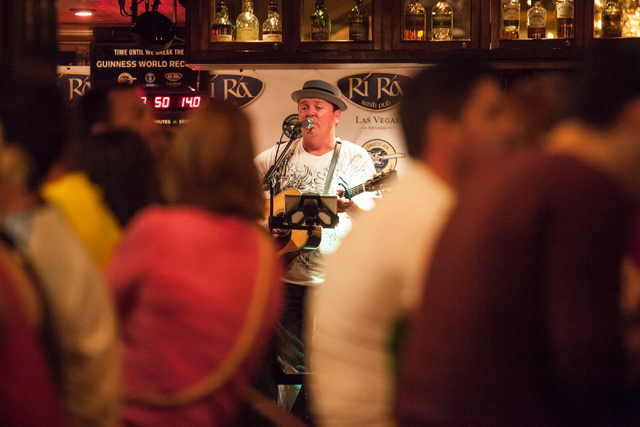 Dave Rooney, center, and Dave Browne, not pictured, perform as the first act during a Guinness World Record attempt for Longest Concert by Multiple Artists at Ri Ra Irish Pub inside The Shoppes at ...