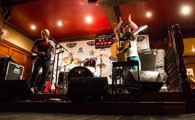 Dave Browne, left, and Dave Rooney perform as the first act during a Guinness World Record attempt for Longest Concert by Multiple Artists at Ri Ra Irish Pub inside The Shoppes at Mandalay Place i ...