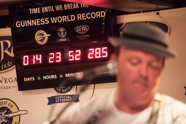 The clock counts down as Dave Rooney performs during a Guinness World Record attempt for Longest Concert by Multiple Artists at Ri Ra Irish Pub inside The Shoppes at Mandalay Place in Las Vegas on ...
