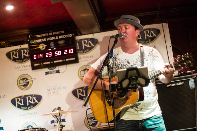 Dave Rooney performs with Dave Browne, not pictured, as the first act during a Guinness World Record attempt for Longest Concert by Multiple Artists at Ri Ra Irish Pub inside The Shoppes at Mandal ...