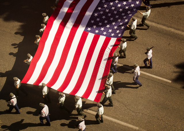 A view of the  Nevada Day Parade on Fourth Street  in downtown Las Vegas is seen Friday, Oct. 31 from the night flood of the Bank of America building. Thousands lined the street to celebrate Nevad ...