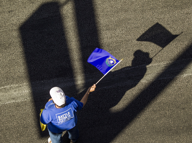 Jamie Makaron waves the Nevada state flag during the   Nevada Day Parade on Fourth Street in downtown Las Vegas on Friday, Oct. 31. Thousands lined the street to celebrate Nevada's  Sesquicentenni ...