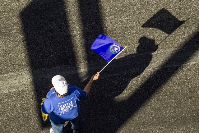 Jamie Makaron waves the Nevada state flag during the Nevada Day Parade on Fourth Street in downtown Las Vegas on Friday, Oct. 31. Thousands lined the street to celebrate Nevada's  Sesquicentennial ...