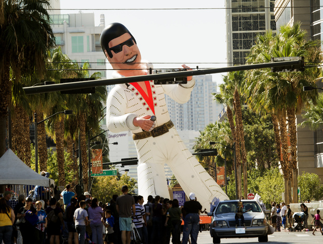 An inflatable Elvis float sponsored by Three Square during the   Nevada Day Parade on Fourth Street in downtown Las Vegas on Friday, Oct. 31. Thousands lined the street to celebrate Nevada's  Sesq ...