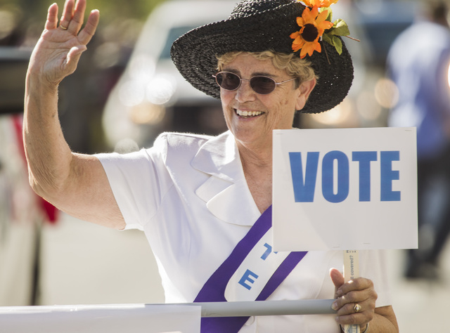Jan Biggerstaff with the Nevada League of Voter Las Vegas march in the  Nevada Day Parade on Fourth Street in downtown Las Vegas on Friday, Oct. 31. Thousands lined the street to celebrate Nevada' ...