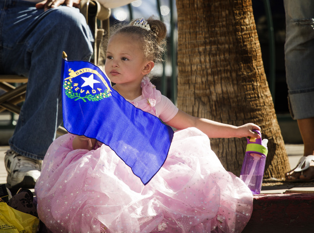 Madison Smith, 3, watches the Nevada Day Parade on Fourth Street in downtown Las Vegas on Friday, Oct. 31. Thousands lined the street to celebrate Nevada's  Sesquicentennial. (Jeff Scheid/Las Vega ...