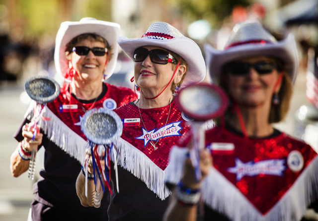 The Plungettes from Texas, from left, Wilda Meixner, Hewlett Wittie and Ronni Davis during the   Nevada Day Parade on Fourth Street in downtown Las Vegas on Friday, Oct. 31. Thousands lined the st ...
