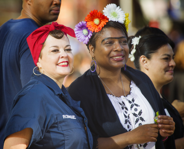 Alicia Cantu,left, and Marsha Palrose watch the Nevada Day Parade on Fourth Street in downtown Las Vegas on Friday, Oct. 31. Thousands lined the street to celebrate Nevada's  Sesquicentennial. (Je ...