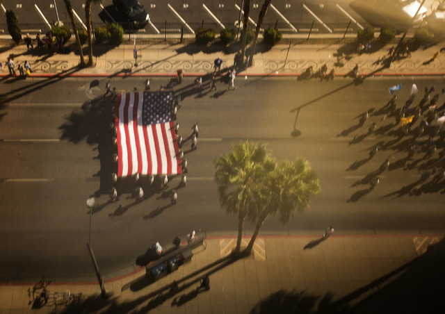 A view of the  Nevada Day Parade on Fourth Street in downtown Las Vegas is seen Friday, Oct. 31 from the night flood of the Bank of America building. Thousands lined the street to celebrate Nevada ...