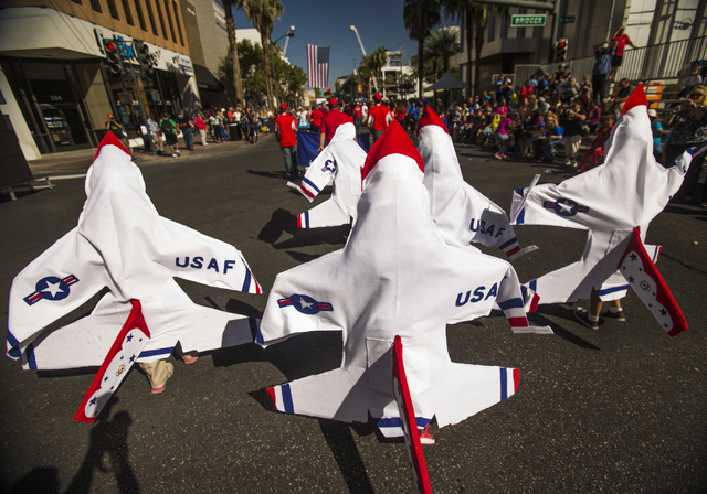 Students from Manch Elementary School dressed in the school's mascot  march in   Nevada Day Parade on Fourth Street in downtown Las Vegas on Friday, Oct. 31. Thousands lined the street to celebrat ...