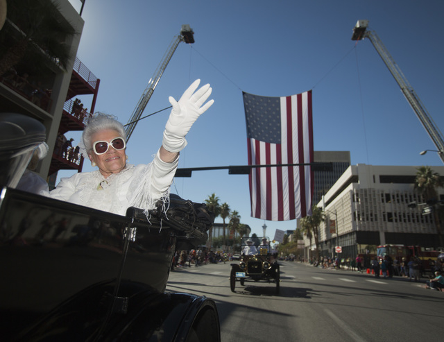 Joan Doubrava  waves while participating in the  Nevada Day Parade on Fourth Street in downtown Las Vegas on Friday, Oct. 31. Thousands lined the street to celebrate Nevada's  Sesquicentennial. (J ...