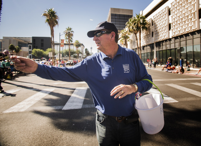 Former Gov. Bob Miller hands out candy in the  Nevada Day Parade on Fourth Street in downtown Las Vegas on Friday, Oct. 31. Thousands lined the street to celebrate Nevada's  Sesquicentennial. (Jef ...